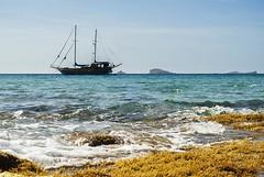 Boat at Cala Comte (PanemEtCircensesDsgn) Tags: digital 50mm nikon ibiza d200 nikkor formentera baleares f18d blearicislands