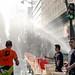 Marathon Paris 2015 by Laurent Tiné :  Ravitaillement en eau des Pompiers de paris. Un arrosage fraicheur au jet d' eau . Merci