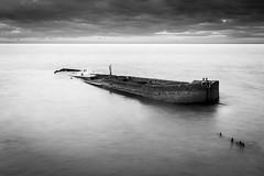 Sunken ship (hzeta) Tags: sunken ship barco hundido wrecked abandonado encallado shipwreck water agua mysterious misterioso black white blanco y negro bw bn