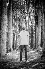 Into the woods (spannerino) Tags: wood trees newzealand blackandwhite black slr film girl childhood contrast analog 35mm vintage person 50mm dof outdoor olympus 35mmfilm scanned vintagecamera analogue ilford zuiko olympusom1 waiheke handprocessed ilfordfp4 filmlives zuiko50mm 50mmlens ilfordlc29 analoguephotography canon9000f
