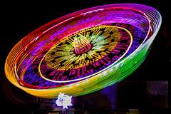 Amusement park - colors (Dino Barsic) Tags: park light color festival night dark lights amusement colorful exposure shadows outdoor spin trails surreal croatia zagreb bundek