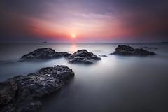 ...Sinking Stones... (Farizun Amrod Saad) Tags: longexposure sunset seascape beach nature landscape rocks stones malaysia slowshutter melaka singhray kualasungaibaru kualalinggi rgnd