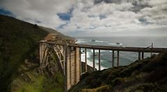 Bixby Bridge (Ryan Gardiner) Tags: ocean california road bridge usa green creek coast nikon rocks waves shadows traffic pacific bigsur roadtrip canyon cliffs montereycounty states lush westcoast bixbycreekbridge stateroute1