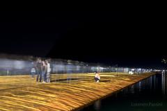 The Floating Piers by night (Lorenzo Passini www.lorenzopassini.it) Tags: orange lake black water night dark long exposure piers floating iseo lorenzopassini thefloatingpiers