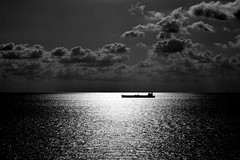 Midnight Freighter (ChristopherSmith.Photo) Tags: ocean light shadow blackandwhite sunlight white black reflection water silhouette clouds contrast dark boat skies ship horizon moonlight rays freighter skancheli