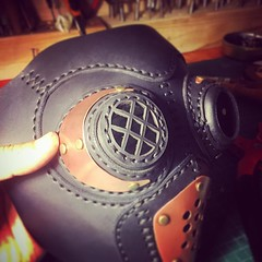 I debated choosing a laser sut acrylic lenses or this grill like piece to complete the eye piece. I think i chose corectly. #Cyberpunk #CyberGoth #postapocalyptic #postapocalypse #steampunk #steampunkmask #leathermask #handmade #LARP #dieselpunk #leather (tovlade) Tags: black girl face make up leather punk hand mask goth goggles made doctor cyber cybergoth cyberpunk plague larp steampunk postapocalyptic postapocalypse dieselpunk