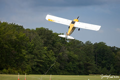 20160716-110340-IMG_0186 (zjernst) Tags: sign museum advertising airplane climb virginia flying aircraft aviation military ad banner aerial propeller takeoff advertise 2016