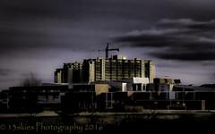 Remnants of the light (HSS) (13skies) Tags: sky abstract mystery buildings dark crane slide slider forboding topaz darkseries slidersunday happyslidersunday