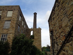 Spot the mysterious figure that appeared on the window sill at the base of the chimney in this old Lancashire mill on Oxford Road, Burnley. The photo was taken on the 12th August 2016 at about 1830hrs. (j.a.sanderson) Tags: chimney factory lancashire burnley figure mystery ghost semiderelict derelict architecture mill