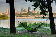 Relaxation (KC Mike D.) Tags: hammock outdoor city skyline downtown reflection people river kaw point missouri kansas architecture park cups drinks relaxation sunset