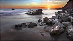 Sinking Sun (B.C.III Photography) Tags: ocean california statepark longexposure sunset sea cliff sun seascape reflection beach water canon sand rocks crystalcove pacificocean dslr seashore lagunabeach
