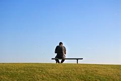 Man on a bench (hannatornblom) Tags: blue sky man green bench nikon solitude alone sitting loneliness sweden horizon lonely sverige kalmar horisont bnk nikon1 nikon1j5