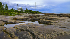 Rocky coast (Joni Mansikka) Tags: summer nature shore bedrock rocky coast sea clouds horizon outdoor landscape green trees coastguardstation kallo pori suomi finland balticsea tamronspaf2875mmf28xrdildasphericalif