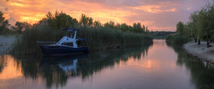 and quiet flows the don (Sergey S Ponomarev) Tags: sergeyponomarev canon 70d nature natura ef24105f40l landscape paysage paesaggio sunset night evening river reflections boat grass flow sholokhov color hdr highdynamicrange clouds sun don volgodonsk rostov russia south sud summer lestate trees panorama  2016                june travel tourism europe