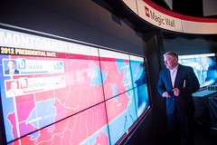 John King tries out the Magic Wall at the Newseum.
