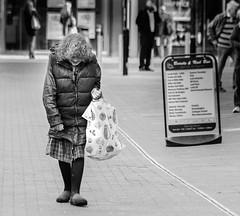 Someone (pootlepod) Tags: street blackandwhite woman monochrome lady shopping hair photography alone pavement sidewalk bags stphotographia
