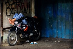 sleeping on his motorcycle (Clinexpat) Tags: street sleeping color feet naked indonesia garage wheels bleu jakarta moto motorcycle sleeper roues cipete