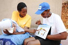 A new mother looks through a health flip book