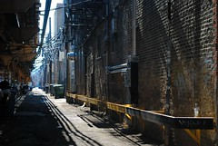 Wicker Park Alley along Milwaukee Ave. (Cragin Spring) Tags: city urban usa wickerpark chicago sunshine illinois spring alley midwest shadows unitedstates unitedstatesofamerica tracks chitown sunny el il northside l elevated chicagoillinois chicagoil windycity milwaukeeave