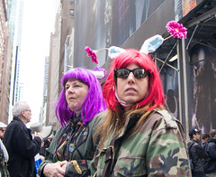 Bunnies in Fatigues (UrbanphotoZ) Tags: nyc newyorkcity flowers ny newyork women manhattan tiger shades midtown camouflage pedestrians wigs rabbitears fatigues redwig fifthave easterparade purplewig