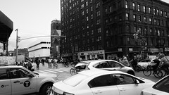 breaking the law (vfrgk) Tags: nyc people blackandwhite bw cars monochrome kids buildings traffic manhattan streetphotography streetlife streetscene junction taxis bicycles urbanmoment trafficjam urbanlife urbanphotography urbanbeauty urbanfragment