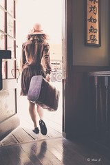 Escape (Photo Alan) Tags: door people woman canada hat vancouver zeiss out leaving escape carl inside exit runaway carlzeiss canon5dsr carlzeissdistagon35mmf14ze