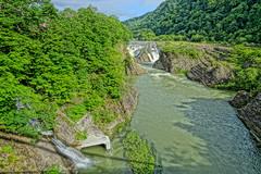 Waterfalls at Takinoue Park (sjrankin) Tags: japan river waterfall hokkaido edited hdr yubari takinouepark yubaririver yubarikawa takinouekoen 24june2016