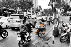 Just another day in Hanoi (Melvin Yue) Tags: road street old city travel bw cars colors fruits monochrome kids 35mm children blackwhite asia vietnamese cityscape colours traffic streetphotography daily wanderlust traveller vietnam explore motorbike fujifilm vendor lonelyplanet hanoi blacknwhite seller bnw photooftheday picoftheday natgeo travelphotography travelgram x100s