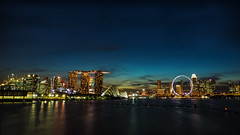 Waterfront Skyline (elenaleong) Tags: bridge architecture buildings twilight singapore icons nightscape dusk landmark manmade bluehour mbs singaporeflyer tgrhusunset elenaleong