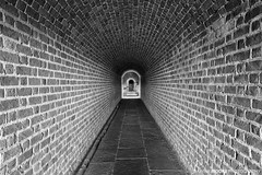 Fort Clinch Tunnel, Fernandina Beach, Florida (DawnaMoorePhotography) Tags: lovefl ameliaisland architectureandbuildings brick fl fernandinabeach florida floridastatepark fortclinch fortclinchstatepark history photography bw blackandwhite bricks civilwarera converginglines dawnamoorephotography dawnamoorephotographycom destination floridasfirstcoast historic historical image monochrome nassaucounty northeastflorida northflorida old passageway photo photograph picture statepark sunshinestate tourism travel tunnel tunnelvision unitedstates usa us
