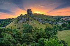 Corfe Castle at Sunrise (Michael Sowerby Photography) Tags: corfe castle dorset jurassic coast purbeck landscape ruins old hills sunrise colour uk england dawn sunburst sun rise
