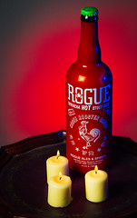 Spicy! (Kurt Miller) Tags: red hot beer candles candle sauce spirits spicy rogue product ales sriracha kurtmiller canon5dmarkiii canon5dmark3