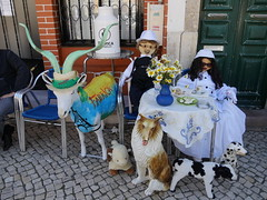 A tradio dos Maios (cyclingshepherd) Tags: flowers people dog flores co dogs cup portugal coffee hat sunglasses animals bread table fun 1 cow avenida bottle chair bonecas sheep chairs may hats goat kitsch sugar queijo vase ces plates algarve boneca tradition cloth tablecloth mayday tableau spectacles daft cabra maio saucer fabrica vaca churn olhao olho jarro pib 2016 maias maios tradico cyclingshepherd