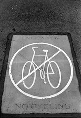 No Cycling (Man with Red Eyes) Tags: park street film monochrome sign analog 35mm cycling blackwhite pavement no dont preston hp5 nikkor ilford prohibited nofilter donot nikonf6 f6 homedeveloped avenham 50mmf12 silverhalide filmisnotdead v850 td201 anchelltroop
