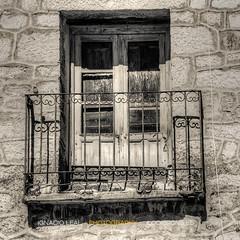 Juliet has gone (ILO DESIGNS) Tags: old windows monochrome architecture rural spain arquitectura village time balcony ventanas balcn antiguo pueblos tiempo monocroma