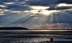 Breaking Through (Tilney Gardner) Tags: clouds nikon harbour dorset sandbanks poole crepuscularrays