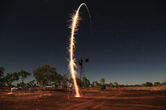 What goes up..... (erglis_m (Mick)) Tags: longexposure sky lightpainting colour windmill night contrast canon stars landscape fire desert fireworks nt fineart australia fullmoon timeexposure dust australianlandscape northernterritory australianoutback reddirt theoutback centraldesert tanami duckponds tanamitrack tanamidesert lajamanu theaustralianoutback warlpiricountry warnayakaartcentre canoneos5dmkiii