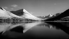 a perfect Northern mirrorworld (lunaryuna) Tags: bw panorama seascape mountains reflection monochrome landscape coast blackwhite iceland fjord lunaryuna seeingdouble waterscape olafsfjordur mirrorworlds northeasticeland