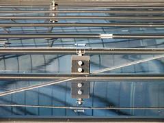Reflection (Lukinator) Tags: blue reflection building window metal architecture silver screw wire dof bokeh background spiegel finepix architektur fujifilm blau middle simple scratch metall reflexion mitte spiegelung reflektion hintergrund silber schraube draht hs20 kratzer simpel