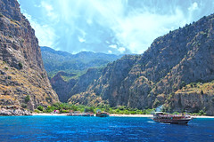 kelebekler vadisi (butterfly Valley) Fethiye/Trkiye (talipcetin) Tags: kelebekler vaisi fethiye plaj deniz butterflies valley beach sea turkuaz kum kumsal crystal cloud sky gemi tur boat mavi bluetour trip travel turkey trkiye tatil holiday sun kamp camp camping butterfly canyon kanyon elale waterfall tekne swim landscape mountain bluff ridge crag