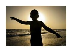 Playeando... (ngel mateo) Tags: ngelmartnmateo ngelmateo playa almera andaluca espaa marmediterrneo cabodegata contraluz silueta puestadesol ocaso atardecer nio sol cielo andalusia spain beach mediterranean backlit silhouette sunset sundown sun sky child