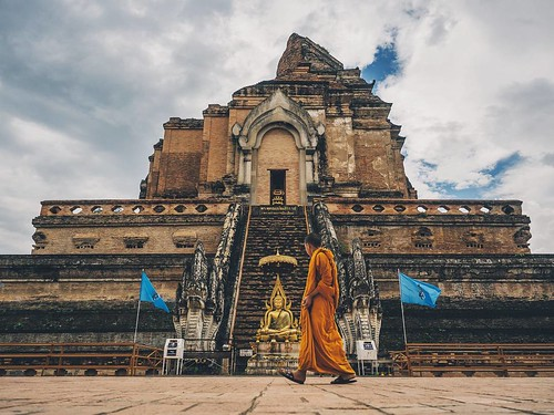 A monk walks in front of the partially collapsed Wat Chedi Luang in Chiang Mai Thailand. #Thailand #monk #temple #wat #chiangmai @KaleidoscopicTravel #KaleidoscopicTravel #thailand #liveintrepid #kaleidoscopic #adventure #amazing #wanderlust #neverstopexp