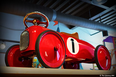 Red toy car (Thad Zajdowicz (Thanks for 2 million+ views!)) Tags: leica red white black color colour car wheel metal writing children toy store play availablelight object ceiling number vignette steeringwheel montgomerycounty zajdowicz
