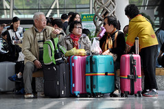 Waiting to fly (Roving I) Tags: china travel tourism waiting shanghai aviation luggage airports pudong baggage suitcases