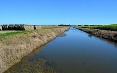 Dungarubba Canal (dustaway) Tags: water reflections vanishingpoint horizon australia bluesky drain nsw plain channel sugarcane cropland northernrivers richmondvalley sugarcanebins richmondriverfloodplains dungarubbacanal