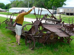 Catherine with old farm machinery (ali eminov) Tags: people architecture buildings machinery catherine missouri museums implements farmmachinery moundcity moundcitymuseum