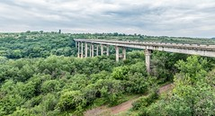 The Bridge to Green World (Alex Demich) Tags: road bridge trees sky people panorama white green nature clouds forest river landscape concrete high cloudy outdoor horizon buh pillar ukraine cloudsstormssunsetssunrises pivdennyi
