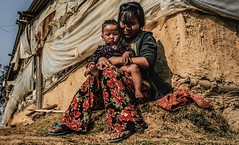 A WOMAN DOLES OUT DISCIPLINE IN THE DISTRICT OF NAGARKOT FAR EAST OF NEPAL. (SUNA_PHOTOGRAPHY) Tags: family nepal nikon child photojournalism lifestyle relief mum survival nagarkot earthquak afteranyear