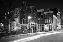 Drive-by shooting (McQuaide Photography) Tags: street old city longexposure nightphotography bridge light blackandwhite bw house holland building history netherlands monochrome dutch amsterdam architecture night zeiss outside mono licht blackwhite europe traffic nacht outdoor sony traditional tripod transport nederland wideangle oldbuildings historic brug fullframe alpha huis singel residential oud stad authentic manfrotto noordholland gebouw c1 huizen straat lighttrail canalhouse verkeer wideanglelens 1635mm northholland grachtenpand groothoek phaseone variotessar captureone mirrorless sonyzeiss mcquaidephotography a7rii ilce7rm2 captureonepro9