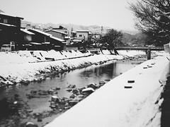 Miyagawa River () (Jon-F, themachine) Tags: winter blackandwhite bw snow seascape water monochrome japan river asian asia waterfront seascapes olympus monochromatic rivers  nippon japo grayscale oriental orient fareast takayama  gifu   bodiesofwater bnw waterside nihon omd  japn hidatakayama 2016      nocolor m43  mft  gifuken bodyofwater     mirrorless   micro43 microfourthirds  ft xapn jonfu  mirrorlesscamera snapseed   em5ii em5markii